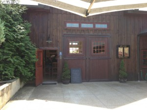 The exterior of the tasting room at Vintage Ridge looks like it could have once been a working, but charming stable